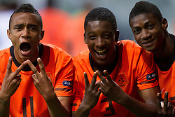 Jeroen Lumu, Riechedly Bazoer and Elton Acolatse of Netherlands celebrate after winning the UEFA European Under-17 Championship Semifinal match between Netherlands and Georgia on May 13, 2012 in SRC Stozice, Ljubljana, Slovenia. Netherlands defeated Georgia 2-0. (Photo by Vid Ponikvar / Sportida.com)