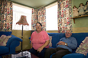 Jim and Christine Gallagher in the living room of their prefab at the Excalibur estate in Catford, South London. Their prefab has been listed this year by the English Heritage. There are 6 of them which were recently listed by the English Heritage among the 187 on the estate.
