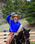 A buckaroo builds a loop in his 60 foot long braided rawhide reata or lariat.