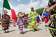 Dancers dressed as Aztec Indians process through the Jardin Allende during a children's parade celebrating Mexican Independence Day celebrations September 17, 2017 in San Miguel de Allende, Mexico.