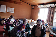 Japanese people fill an evacuation center trying to keep warm as winter weather made a miserable situation worse on March 23, 2011 in Miyagi, Japan.
