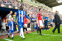 WIGAN, ENGLAND - Saturday, August 22, 2009: Manchester United's captain Gary Neville and Wigan Athletic's captain Mario Melchiot during the Premiership match at the DW Stadium. (Photo by David Rawcliffe/Propaganda)