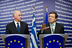"George Papandreou, Greece's prime minister, left, listens as Jose Manuel Barroso, president of the European Commission, speaks, during a press briefing following their meeting at the European Union Commission headquarters in Brussels, Belgium, on Wednesday, March 17, 2010. German Chancellor Angela Merkel said the European Union must avoid any ""overly hasty"" aid pledge to Greece. (Photo © Jock Fistick)"