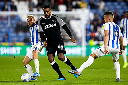 Tom Huddlestone of Derby County takes on Alex Pritchard of Huddersfield Town and Jonathan Hogg of Huddersfield Town - Mandatory by-line: Robbie Stephenson/JMP - 05/08/2019 - FOOTBALL - The John Smith's Stadium - Huddersfield, England - Huddersfield Town v Derby County - Sky Bet Championship