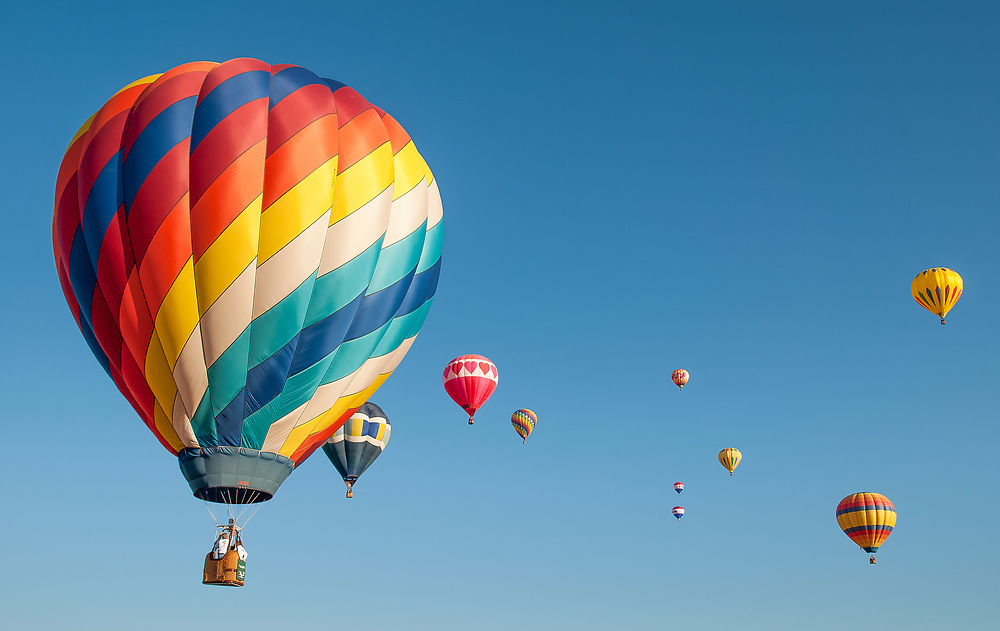 A picture of hot air balloons flying in the sky.<br /> <br /> Camera <br /> NIKON D5000<br /> Lens <br /> 17.0-70.0 mm f/2.8-4.0<br /> Focal Length <br /> 24<br /> Shutter Speed <br /> 1/400<br /> Aperture <br /> 10<br /> ISO <br /> 200