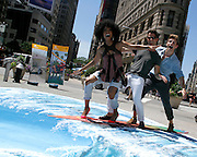 Brandy Norwood, Nate Berkus and Jeremiah Brent ride a wave during the #VisitAnaheim in 3D event in the Flatiron District in New York City, New York on June 24, 2015.