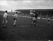 15/02/1959<br /> 02/15/1959<br /> 15 February 1959<br /> Soccer, F.A.I. Cup: Waterford v Transport at Harold's Cross, Dublin. Transport goalie K. Blount clears from this forward rush on the Transport goal.