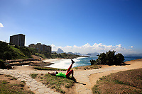 women stretching on arpoador beach near copacabana beach in rio de janeiro in brazil
