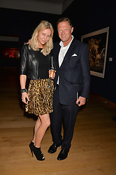 LORD ST.JOHN OF BLETSO and SABINA MCTAGGART at the Christie's Conservation Lectures in aid of Tusk held atChristie's, 8 King Street, London on 30th April 2014.