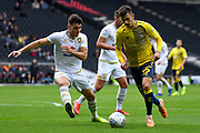 Coventry City midfielder Zain Westbrooke (25) battles for possession  with Milton Keynes Dons defender Jordan Moore-Taylor (15) during the EFL Sky Bet League 1 match between Milton Keynes Dons and Coventry City at stadium:mk, Milton Keynes, England on 19 October 2019.