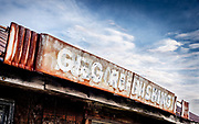 A detail of an abandoned country store sign.  Image was processed to emulate Kodachrome 25 color slide film.