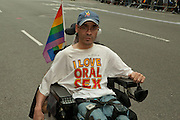 "Disabled participant in the 2011 Pride Parade in New York, wearing a tee short reading ""I Love Oral Sex."""