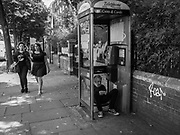 MAN ON A CELLPHONE IN A PHONEBOX, Notting Hill, London, 25 August 2017