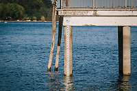 ANGUILLARA SABAZIA (LAKE BRACCIANO), ITALY - 26 JULY 2017: A stage (or hydrometic measurement) indicates the water level at minus 1,50m on a jetty here in Anguillara Sabazia (Lake Bracciano), Italy, on July 26th 2017.<br /> <br /> Lake Bracciano provides eight percent of Rome's water and has sunk about 1.5 meters<br /> <br /> A severe drought and sweltering temperatures have led Rome city officials to consider a potential rationing of drinking water for eight hours a day for a million and a half Rome residents. The water crisis has become yet another sign of man being at the mercy of an increasingly extreme climate, but also of once mighty Rome's political impotence, managerial ineptitude and overall decline.