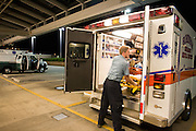 Joe Shutka of Robinson EMS gets ready to move an accident victim to the  Allegheny General Hospital's Emergency Room.