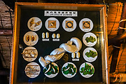 "Life cycle of silkworm. In Ogimachi, the peaceful Gassho-zukuri Minka-en Outdoor Museum displays farmhouses relocated from surrounding villages. Ogimachi is the largest village and main attraction of the Shirakawa-go region, in Ono District, Gifu Prefecture, Japan. Declared a UNESCO World Heritage Site in 1995, Ogimachi village hosts several dozen well preserved gassho-zukuri farmhouses, some more than 250 years old. Gassho-zukuri means ""constructed like hands in prayer"", as the farmhouses' steep thatched roofs resemble the hands of Buddhist monks pressed together in prayer. Their thick roofs, made without nails, are designed withstand harsh, snowy winters and to protect a large attic space that was formerly used to cultivate silkworms. Many of the farmhouses are now restaurants, museums or minshuku lodging."
