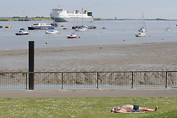 © Licensed to London News Pictures. 16/05/2014<br /> Sunny weather in Gravesend today(16.05.2014)<br /> Today is the start of a mini heatwave weekend with temperatures set to hit 24C across parts of the UK.<br />  People enjoying the hot weather at Gravesend Riverside,Gravesend,Kent  with the temperature at 21C in Gravesend today it is normally one of the hottest places in the UK, with views of the River Thames and Tilbury Power Station.<br /> Photo credit :Grant Falvey/LNP
