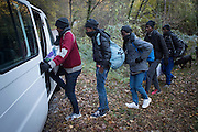 November 8, 2016,  Breil-sur-Roya, French Alpes, France. Eritrean refugees who spent the night in the house of Eloïse, quickly enter Sylvains van to be transported over the mountains to a safe train station. By doing so the driver, Sylvain, , 67 years, a retired school teacher, risks police arrests and a trial.<br /> <br /> 8 novembre 2016, Breil-sur-Roya, Alpes françaises, France. Des réfugiés érythréens qui ont passé la nuit dans la maison d'Eloïse, entrent dans la camionnette de Sylvain pour être transportés au-dessus des montagnes vers une gare jugée sûre. Ce faisant Sylvain, 67 ans, prof à la retraite, risque d'être arrêté et jugé.