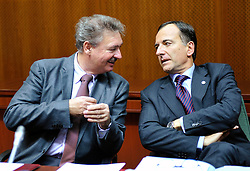 Jean Asselborn, Luxembourg's foreign minister, left, speaks with Franco Frattini, Italy's finance minister, during the European Summit, in Brussels, Belgium, Wednesday, Oct. 15, 2008.   (Photo © Jock Fistick)