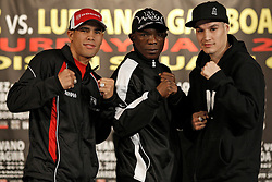 Jan 21, 2010; New York, NY; USA;  Challenger Juan Manuel Lopez (l) and WBO Champion Steven Luevano (r) pose with Rogers Mtagwa (c) after the final press conference for their fight.  The two will meet on January 23, 2010 at the Theater at Madison Square Garden.