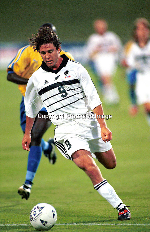 Paul Urlovic of New Zealand U23 Oly Whites Soccer plays the Solomon Islands in an  Olympic Qualifier match in 1999. Photo: Dean Treml/Photosport.co.nz
