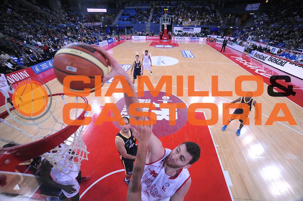 DESCRIZIONE : Pesaro Lega A 2013-14 VL Pesaro Sutor Montegranaro<br /> GIOCATORE : Marc Trasolini<br /> CATEGORIA : schiacciata special<br /> SQUADRA : VL Pesaro Sutor Montegranaro<br /> EVENTO : Campionato Lega A 2013-2014<br /> GARA : VL Pesaro Sutor Montegranaro<br /> DATA : 23/02/2014<br /> SPORT : Pallacanestro <br /> AUTORE : Agenzia Ciamillo-Castoria/C.De Massis<br /> Galleria : Lega Basket A 2013-2014  <br /> Fotonotizia : Pesaro Lega A 2013-14 VL Pesaro Sutor Montegranaro<br /> Predefinita :