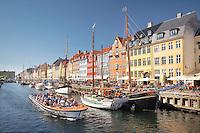 A tourist boat on a canal in Nyhavn, Copenhagen, Denmark.