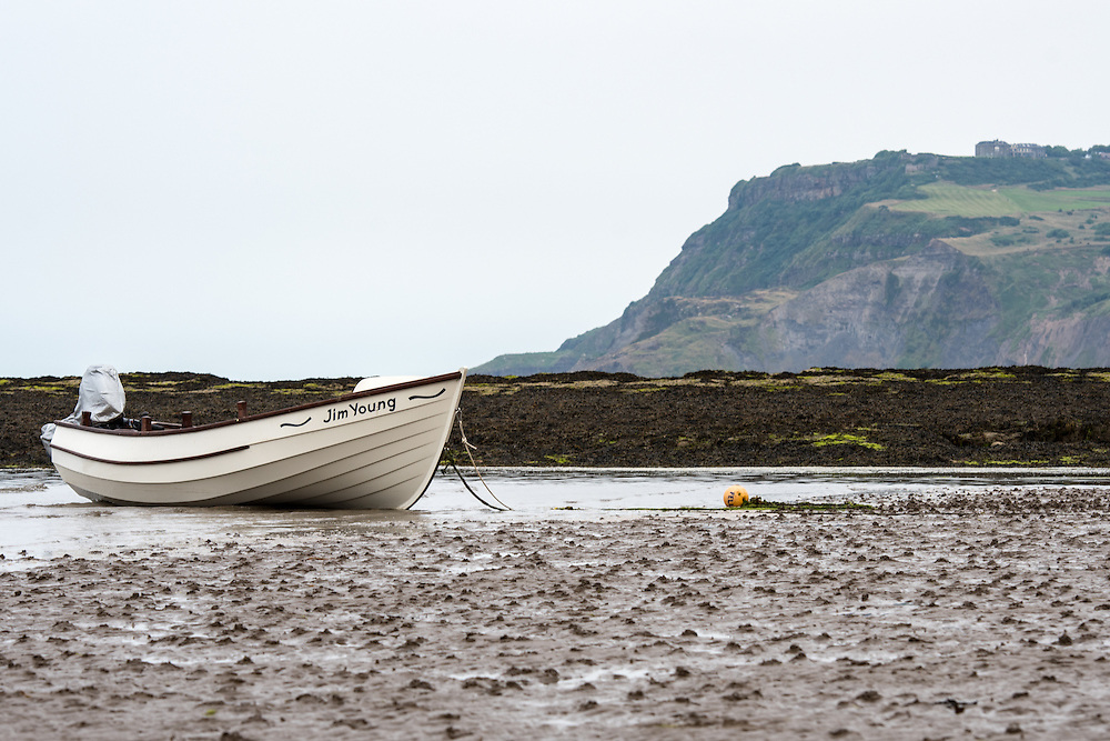 UK, England, Yorkshire - A boat on the beach right outside the small fishing village called Robin Hood's Bay, located on the coast of North Yorkshire, England.