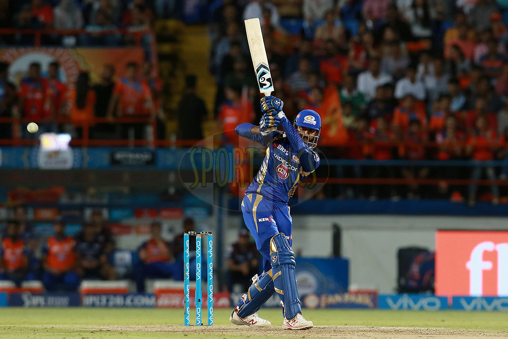 Krunal Pandya of MI plays a shot during match 35 of the Vivo 2017 Indian Premier League between the Gujarat Lions and the Mumbai Indians  held at the Saurashtra Cricket Association Stadium in Rajkot, India on the 29th April 2017<br /> <br /> Photo by Rahul Gulati - Sportzpics - IPL