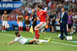 Stuart Dallas of Northern Ireland fouls Gareth Bale of Wales  - Mandatory by-line: Joe Meredith/JMP - 25/06/2016 - FOOTBALL - Parc des Princes - Paris, France - Wales v Northern Ireland - UEFA European Championship Round of 16