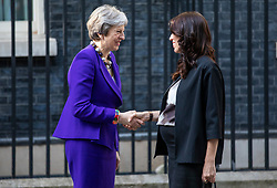 © Licensed to London News Pictures. 18/04/2018. London, UK. Prime Minister Theresa May (L) and Prime Minister of New Zealand Jacinda Ardern (R) greet each other on Downing Street. Photo credit: Rob Pinney/LNP
