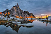 Prusik Peak, Gnome Tarn and alpine larch trees at sunrise; The Enchantments, Alpine Lakes Wilderness, Washington.
