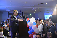 Garden City, New York, USA. November 6, 2018. Nassau County Democrats watch Election Day results at Garden City Hotel, Long Island. JAY JACOBS, Chairman of Nassau County Democratic Committee, is at podium, is introducing Congressman Tom Suozzi who won re-election.