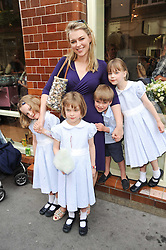 LADY DALMENY with her children, left to right, the HON.CELESTE PRIMROSE, the HON.LAVINIA PRIMROSE, the HON.CASPIAN PRIMROSE and the HON.DELPHI PRIMROSE at Papillon Shoes Enchanted Tea Party Store Launch 98 Marylebone Lane, London W1 on 25th May 2010.