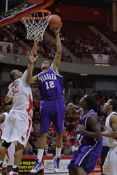 12 December 2009: Scooter Gillette slips past the coverage of Jackie Carmichael. The Purple Eagles of Niagara defeat the Redbirds of Illinois State 76-68 on Doug Collins Court inside Redbird Arena in Normal Illinois.