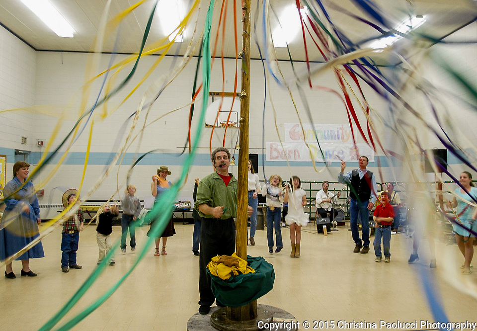 American Folk Dance caller Terrence Smith of Duluth leads a Maypole dance at a Old Time Barn Dance at Ridgeway School Friday evening.  The end of the school year event included square, line, waltz and other dances. The charter school has 61 students  enrolled with pre K through 5th grade .  <br /> (Rochester Post-Bulletin,Christina Paolucci)
