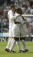Photo Aidan Ellis.Digitalsport<br /> Bolton Wanderers v Charlton Athletic.<br /> FA Barclaycard Premiership.<br /> 14/08/2004.<br /> Bolton's Jay-Jay Okocha is mobbed by team mates Nicky Hunt and Ricardo Gardener after scoring  a stunning free kick