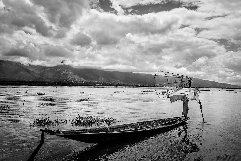 A fisherman shows off his acrobatic skills. Inle Lake, Myanmar