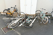 bicycle parking with fallen over bikes Japan Yokosuka