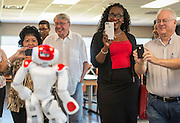 Houston ISD trustee Wanda Adams watches a robotics demonstration following a ribbon cutting ceremony at South Early College High School, October 8, 2016.