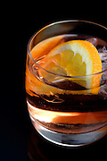 Glass of beverage with ice