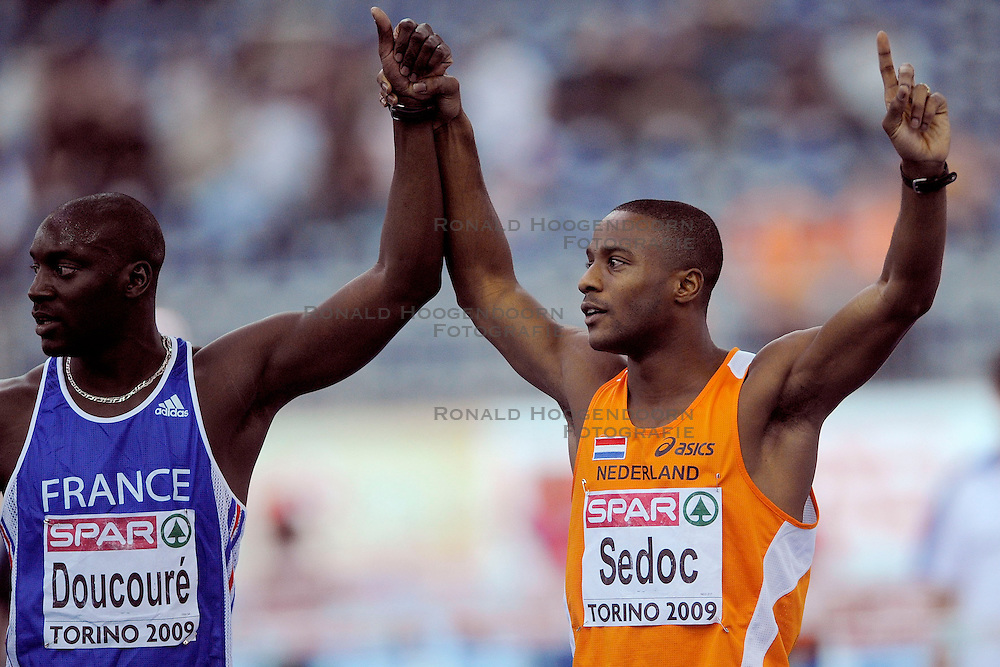 06-03-2009 ATLETIEK: EK INDOOR: TURIJN <br /> Gregory Sedoc wint de zilveren medaille op de 60 meter horden en de fransman Ladji Doucoure wint met dezelfde tijd de gouden medaille<br /> &copy;2009-WWW.FOTOHOOGENDOORN.NL
