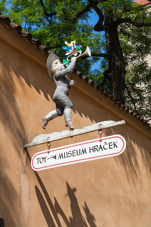 Hand lettered sign decorated with toy trumpeter for Prague Toy Museum