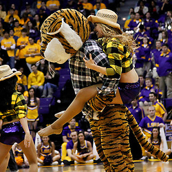 February 11, 2012; Baton Rouge, LA; LSU Tigers mascot Mike the Tiger carries a tiger girl dancer during a performance in the second half of a game against the Alabama Crimson Tide at the Pete Maravich Assembly Center. LSU defeated Alabama 67-58.  Mandatory Credit: Derick E. Hingle-US PRESSWIRE