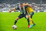 Javier Manquillo (#19) of Newcastle United FC holds off Gabriel Martinelli (#35) of Arsenal FC during the Premier League match between Newcastle United and Arsenal at St. James's Park, Newcastle, England on 11 August 2019.