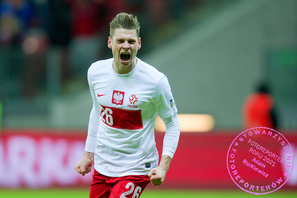 Lukasz Piszczek of Poland celebrates his goal for Poland during the 2014 World Cup Qualifying Group H soccer match between Poland and Ukraine at National Stadium in Warsaw on March 22, 2013...Poland, Warsaw, March 22, 2013...Picture also available in RAW (NEF) or TIFF format on special request...For editorial use only. Any commercial or promotional use requires permission...Photo by © Adam Nurkiewicz / Mediasport