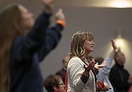 Pam Fritag of Marion prays during The Response Iowa at River of Life Ministries, 3801 Blairs Ferry Rd NE, in Cedar Rapids on Tuesday evening, December 6, 2011. The Response gathered people from all ages, denominations and backgrounds in prayer and fasting on behalf of the nation. (Stephen Mally/Freelance)