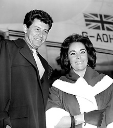 Newlyweds Elizabeth Taylor and Eddie Fisher arrive at London Airport from Nice.
