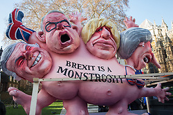 London, UK. 11th December, 2018. Figures of Nigel Farage, Michael Gove, Boris Johnson and Theresa May on the back of a truck during pro- and anti-Brexit activists outside Parliament on the day on which a vote was originally to have been scheduled on completion of a House of Commons debate on the Government's draft Brexit withdrawal agreement.