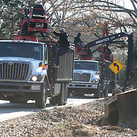 Tupelo Public Works truck are still picking up storm damage along Butler Road Wednesday nearly a month after the tornado.